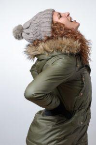 woman coat back pain