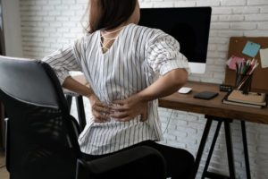 woman desk back pain