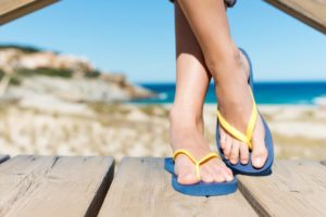 feet with flip-flops and back pain