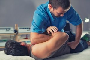 chiropractor treating a patient with back pain